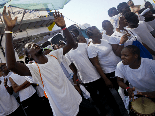 "African migrants sing and dance on the deck of the Aquarius vessel of ""SOS Mediterranee"" and MSF (Doctors Without Borders) NGOs, in the Mediterranean Sea, west of Malta, Thursday, Aug. 31, 2017. 265 people rescued from the sea during previous days are being transferred to Italy. (AP Photo/Darko Bandic)"