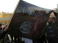 Palestinian Salafists deploy a giant al-Qaeda-affiliated flag during a protest against the printing of satirical sketches of the Prophet Mohammed by French satirical weekly Charlie Hebdo on January 19, 2015 on their way to the French Cultural Centre in Gaza city. The walls of Gaza's French Cultural Center were painted on January 16 with graffitti in reaction to a cartoon published in the latest issue of Charlie Hebdo showing on its cover the prophet Mohammed holding a 'Je Suis Charlie' (I am Charlie) sign under the headline 'All is forgiven'. AFP PHOTO / MAHMUD HAMS (Photo credit should read MAHMUD HAMS/AFP/Getty Images)