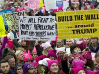 Women with bright pink hats and signs begin to gather early and are set to make their voices heard on the first full day of Donald Trump's presidency, Saturday, Jan. 21, 2017 in Washington. Organizers of the Women's March on Washington expect more than 200,000 people to attend the gathering. Other protests are expected in other U.S. cities. (AP Photo/Jose Luis Magana)