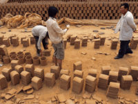 A man searched for his child, one of hundreds who have been kidnapped, at this brick kiln in China's Shanxi Province. Credit Color China Photo, via Associated Press