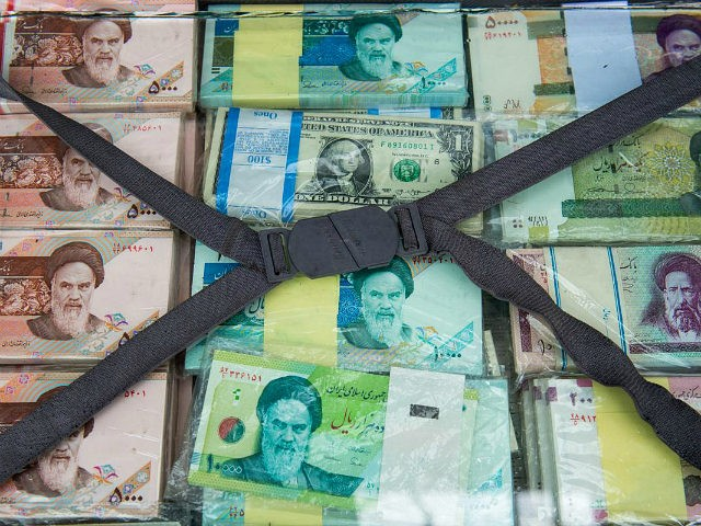 A briefcase filled with Iranian rial banknotes sits on display at a currency exchange market on Ferdowsi street in Tehran, Iran, on Saturday, Jan. 6, 2018. A wave of bad loans from unregulated lenders has rocked the banking sector and oil prices have averaged less than $60 a barrel for …
