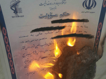More images emerging of #Iran-ians burning their #Basij membership cards in show of support for #IranProtests.