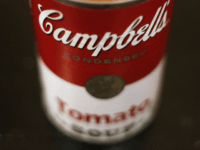This Aug. 31, 2011 file photo shows an opened can of Campbell's Tomato soup in New York. Campbell Soup Co. said Tuesday, Nov. 22, 2011, fiscal first-quarter net income fell 5 percent as price increases were not enough to offset lower volume in its soup and beverage businesses (AP Photo/James …