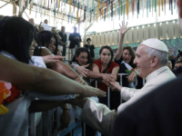 Pope Francis greets inmates at the San Joaquin women's prison in Santiago, Chile, Tuesday, Jan. 16, 2018. (AP Photo/Alessandra Tarantino, Pool)