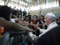 Pope Francis greets inmates at the San Joaquin women's prison in Santiago, Chile, Tuesday, Jan. 16, 2018. (AP Photo/Alessandra Tarantino, Pool)