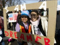 DemonstratorsKarina Velasco, left, and Gabi Sanchez hold a sign during an immigration rally in support of the Deferred Action for Childhood Arrivals (DACA), and Temporary Protected Status (TPS), programs, on Capitol Hill in Washington, Wednesday, Dec. 6, 2017. ( AP Photo/Jose Luis Magana)