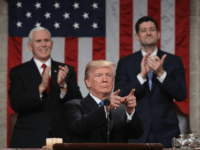 US President Donald Trump delivers the State of the Union address as US Vice President Mike Pence (L) and Speaker of the House US Rep. Paul Ryan (R-WI) (R) clap in the chamber of the US House of Representatives in Washington, DC, on January 30, 2018. / AFP PHOTO / …