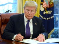 U.S. President Donald Trump signs Section 201 actions in the Oval Office of the White House in Washington, D.C., U.S., on Tuesday, Jan. 23, 2018. Trump slapped tariffs on imported solar panels and washing machines on Monday in his first major move to level a global playing field he says …