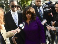 Former congresswoman Corrine Brown walks into Federal Court accompanied by pastor Rudolph McKissick, Sr. Brown appeared in Federal Court to be sentenced on fraud charges. Her former chief of staff, Ronnie Simmons and One Door for Education President Carla Wiley will also be sentenced. (Bob Mack/The Florida Times-Union via AP)