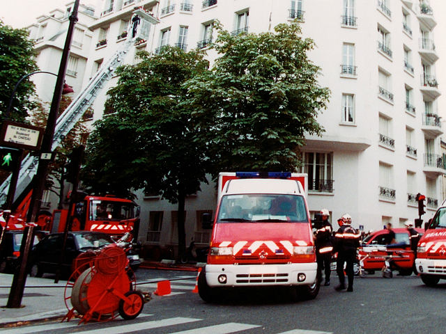 Firefighters use a ladder, left, to reach the 6th floor of a building in Neuilly-sur-Seine, outside Paris, in this photo taken Saturday Sept. 14, 2002. Five firefighters were killed by two explosions as they tried to extinguish a blaze in this residential building, it was the biggest loss in the …