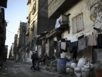 In this Thursday Jan. 11, 2018 photo, Palestinians sit outside their house in the Shati refugee camp in Gaza City. From the Gaza Strip to Jordan and Lebanon, millions of Palestinians are bracing for the worst as the Trump administration moves toward cutting funding to the U.N. agency that assists …