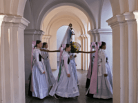 Women dressed in the traditional clothes of the Sorbs carry the statue of Virgin Mary during a procession in the church in Rosenthal, eastern Germany, Monday, June 5, 2017. Traditionally on Whit Monday catholic faithful Sorbs, a Slavic minority near the German-Polish border, celebrate an open air mass in the …