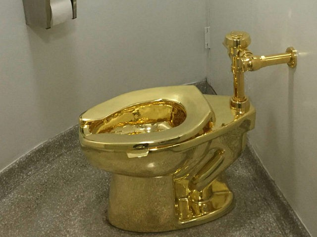 A fully functioning solid gold toilet, made by Italian artist Maurizio Cattelan, is going into public use at the Guggenheim Museum in New York on September 15, 2016. A guard will be stationed outside the bathroom to protect the work, entitled 'America', which recalls Marcel Duchamp's famous work, 'Fountain'. / …