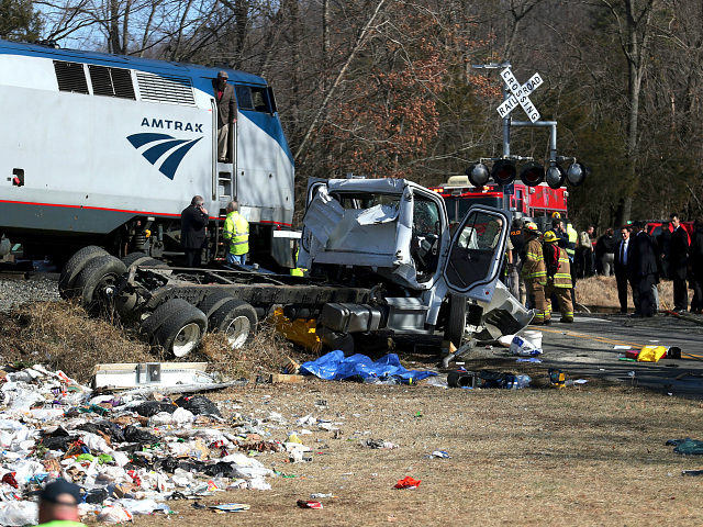 Emergency personnel work at the scene of a train crash involving a garbage truck in Crozet, Va., on Wednesday, Jan. 31, 2018. An Amtrak passenger train carrying dozens of GOP lawmakers to a Republican retreat in West Virginia struck a garbage truck south of Charlottesville, Va. No lawmakers were believed …