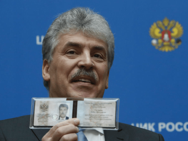 Communist Party candidate, businessman Pavel Grudinin shows his presidential candidate certificate shortly after receiving it at the Central Election Commission in Moscow on January 12, 2018. Russia's presidential election is scheduled for March 18, 2018. / AFP PHOTO / Alexander NEMENOV (Photo credit should read ALEXANDER NEMENOV/AFP/Getty Images)