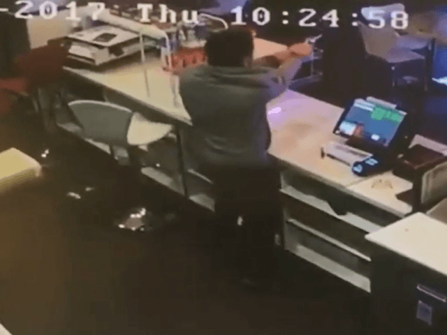 A cafe owner wrestled a gun away from one of three robbery suspects and opened fire as the suspects ran out the front door.