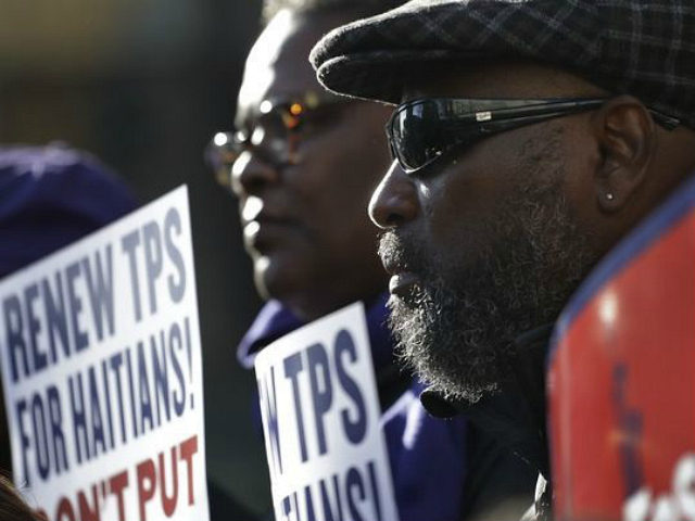 Immigration advocates rally in New York on Tuesday, Nov. 21, 2017, to protest the decision by the Department of Homeland Security to terminate Temporary Protected Status for people from Haiti. The Homeland Security Department said conditions in Haiti have improved significantly, so the benefit will be extended until July 2019 …
