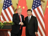 FILE: U.S. President Donald Trump, left, and Xi Jinping, China's president, shake hands during a news conference at the Great Hall of the People in Beijing, China, on Thursday, Nov. 9, 2017. The one year anniversary of U.S. President Donald Trump's inauguration falls on Saturday, January 20, 2018. Our editors …