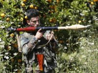 A Hezbollah fighter holds an RPG as he takes his position between orange trees, at the coastal border town of Naqoura, south Lebanon, Thursday, April 20, 2017. Hezbollah organized a media tour along the border with Israel meant to provide an insight into defensive measures established by the Israeli forces …