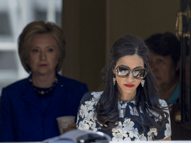 Top Clinton aide Huma Abedin walks ahead of Democratic presidential candidate Hillary Clinton following a private meeting with Sen. Elizabeth Warren, D-Mass., Friday, June 10, 2016, at Clinton's home in Washington. The FBI has obtained a warrant to begin reviewing newly discovered emails that may be relevant to the Hillary …