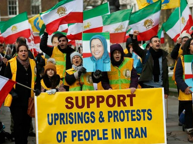 The Anglo-Iranian communities, supporters of Iran's democratic opposition, the National Council of Resistance of Iran (NCRI) and main organised opposition movement PMOI, hold a rally opposite the entrance of 10 Downing Street in London, Thursday, Jan. 4, 2018, in solidarity with the nationwide anti-regime protests in Iran. (AP Photo/Frank Augstein)