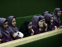 Iranian school girls observe Members of Parliament (MP) discussing a draft to limit photographer's and cameramen's access to cover parliament's open sessions in Tehran on February 27, 2013. The debate took part on the sidelines of a parliamentary session to discuss the annual budget bill which is being presented by …