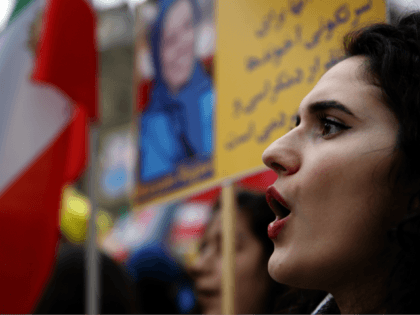 Demonstrators of the National Council of Resistance of Iran protest near the Iran's embassy in Paris, Saturday, Jan. 6, 2018, in solidarity with those demonstrating in Iran. Iran has seen its largest anti-government protests since the disputed presidential election in 2009, with thousands taking to the streets in several cities …