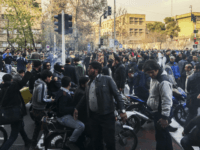 In this photo of Iranian protests taken by an individual not employed by the Associated Press and obtained by the AP outside Iran, demonstrators gather to protest against Iran's weak economy, in Tehran, Iran, Saturday, Dec. 30, 2017. A wave of spontaneous protests over Iran's weak economy swept into Tehran …