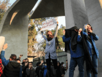 Iranian students protest at the University of Tehran during a demonstration driven by anger over economic problems, in the capital Tehran on December 30, 2017. Students protested in a third day of demonstrations sparked by anger over Iran's economic problems, videos on social media showed, but were outnumbered by counter-demonstrators. …