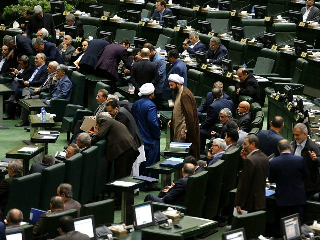 Iranian MPs attend President Rouhani's presentation of the for 2018-2019 budget to the parliament on December 10, 2017, in Tehran. / AFP PHOTO / ATTA KENARE (Photo credit should read ATTA KENARE/AFP/Getty Images)