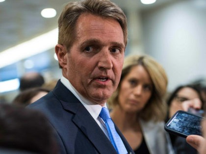 US Republican Senator from Arizona Jeff Flake speaks to reporters after a closed briefing by Joint Chiefs of Staff Gen. Joseph Dunford at the Capitol in Washington, DC, on April 7, 2017 the day after the US hit Syria. / AFP PHOTO / NICHOLAS KAMM (Photo credit should read NICHOLAS …