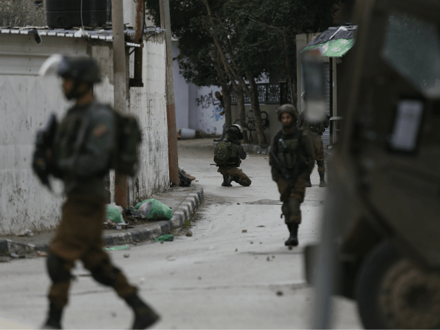 Israeli troops patrol the streets of the West Bank city of Jenin, Thursday, Jan. 18, 2018. Israeli police say special forces killed a Palestinian gunman in the West Bank who allegedly killed an Israeli in a drive-by shooting earlier this month. (AP Photo/Majdi Mohammed)