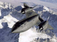 SR-71B Blackbird aerial reconnaissance aircraft photographed over snow capped mountains in 1995.