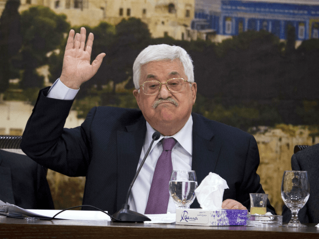 Palestinian President Mahmoud Abbas, speaks during a meeting with the Palestinian Central Council, a top decision-making body, at his headquarters in the West Bank city of Ramallah, Sunday, Jan. 14, 2018 . (AP Photo/Majdi Mohammed,l)