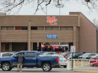 Emergency crews respond to Marshall County High School after a fatal school shooting in Benton, Kentucky (RYAN HERMENS/AP)