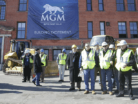 onstructions workers gather on the site to watch a ground breaking ceremony for the $800 million MGM casino resort scheduled to open in 2017, Tuesday, March 24, 2015, in Springfield, Mass., Tuesday, March 24, 2015, in Springfield, Mass. The casino resort, the largest economic development project the region has seen in generations, is scheduled to open in 2017. Springfield's MGM is the first of three casino resorts expected to open in the state. (AP Photo/Stephan Savoia)