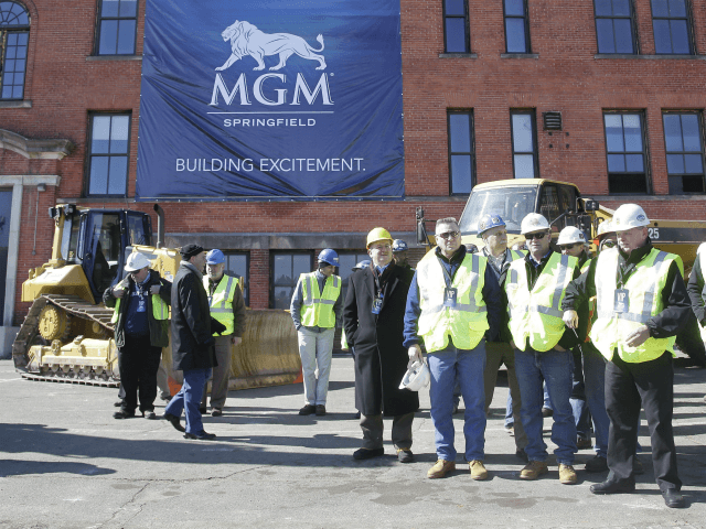 onstructions workers gather on the site to watch a ground breaking ceremony for the $800 million MGM casino resort scheduled to open in 2017, Tuesday, March 24, 2015, in Springfield, Mass., Tuesday, March 24, 2015, in Springfield, Mass. The casino resort, the largest economic development project the region has seen …