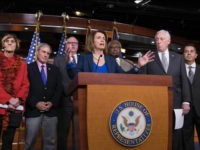 House Minority Leader Nancy Pelosi, D-Calif., is joined by fellow Democrats, from left, Rep. Rosa DeLauro, D-Conn., Rep. John Yarmuth, D-Ky., Rep. Joe Crowley, D-N.Y., Rep. James E. Clyburn, D-S.C., Minority Whip Steny Hoyer, D-Md., and Rep. Ben Ray Lujan, D-N.M., as she speaks during a news conference on Capitol Hill in Washington, Friday, Jan. 19, 2018. (AP Photo/J. Scott Applewhite)