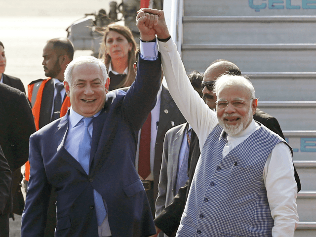 Israel's Prime Minister Benjamin Netanyahu, left, is welcomed by India's Prime Minister Narendra Modi on his arrival at Palam airport in New Delhi Sunday, Jan. 14, 2018. Israeli Prime Minister Netanyahu arrived Sunday for his first visit to India to expand defense, trade and energy ties. (AP Photo)