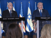 U.S. Vice President Mike Pence, left, listens as Israel's Prime Minister Benjamin Netanyahu delivers a statement in the Prime Minister's residence in Jerusalem, Monday, Jan. 22, 2018. (AP Photo/Ariel Schalit, Pool)