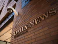 Signage for the New York Daily News is displayed on the facade of their Broad Street office, September 5, 2017 in New York City. Tronc, the publisher of the Chicago Tribune and The Los Angeles Times newspapers, announced on Monday that is had purchased The New York Daily News. Previously …