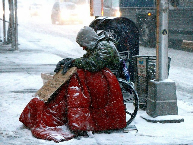 NEW YORK, NY - JANUARY 4: A Homeless man pictured during the 'Bomb Cyclone' storm in New York City on January 4, 2018. Credit: RW/MediaPunch/IPX