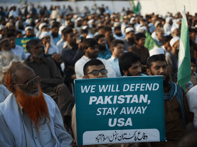 Supporters of the Pakistan Defense Council, an alliance of hardline Islamist religious leaders and politicians, gather during an anti-U.S protest in Islamabad on August 27, 2017. Pakistan's political, religious and military leaders have rejected President Donald Trump's allegation that Islamabad is harboring militants who battle U.S. forces in Afghanistan. / …