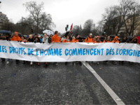 Pro-life demonstrators hold banners reading 'Human rights begin from the origin' in Paris on January 21, 2018 during a 'March for life' demonstration against abortion and medically assisted procreation. / AFP PHOTO / Eric FEFERBERG (Photo credit should read ERIC FEFERBERG/AFP/Getty Images)