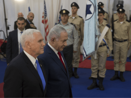 U.S. Vice President Mike Pence walks with Israel's Prime Minister Benjamin Netanyahu in Jerusalem, Monday, Jan. 22, 2018. Pence is receiving a warm welcome in Israel, which has praised the American decision last month to recognize Jerusalem as Israel's capital. The decision has infuriated the Palestinians and upset America's Arab allies as well. (AP Photo/Ariel Schalit)