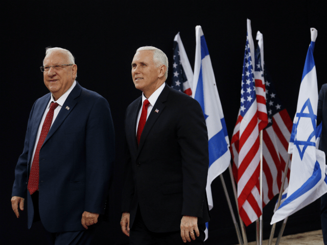 U.S. Vice President Mike Pence, right, walks alongside Israel President Reuven Rivlin during a formal reception ceremony at the President's residence in Jerusalem, Tuesday Jan. 23, 2018. (Ronen Zvulun/Pool via AP)