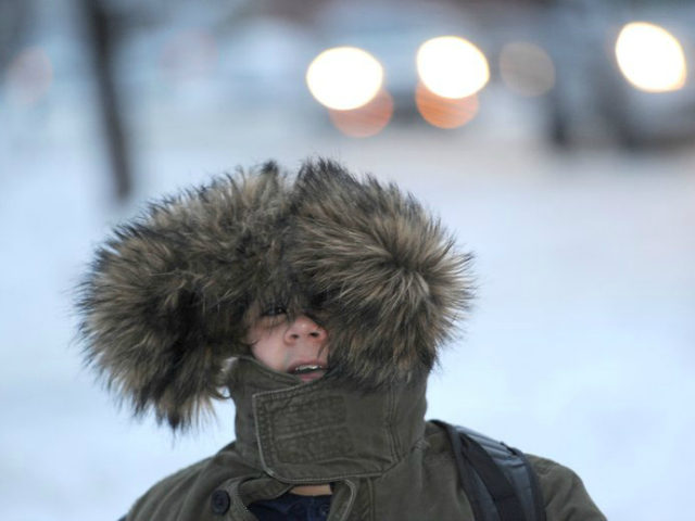 Kasim Kantarevic, 12, keeps his hood up as he walks to school on Thursday, Dec. 15, 2016 in Erie, Pa. Much of the northern Mid-Atlantic and Northeast will stay cold for the next couple of days as the arctic air remains stuck over the northern Appalachians, the National Weather Service said. (Christopher Millette/Erie Times-News via AP)