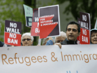 FILE--In this May 15, 2017, file photo, protesters hold signs during a demonstration against President Donald Trump's revised travel ban, Monday, May 15, 2017, outside a federal courthouse in Seattle. Trump's six-month worldwide ban on refugees entering the United States is ending as his administration prepares to unveil new screening …