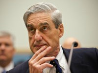 FILE - In this June 13, 2013 file photo, FBI Director Robert Mueller listens as he testifies on Capitol Hill in Washington, as the House Judiciary Committee held an oversight hearing on the FBI. Special Counsel Robert Mueller's team of lawyers investigating potential coordination between Russia and the Trump campaign …