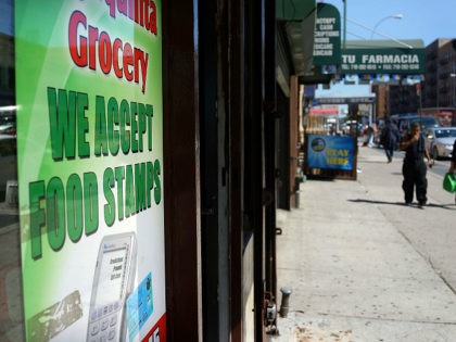 NEW YORK, NY - SEPTEMBER 19: A grocery store advertises that they accept food stamps in the South Bronx on September 19, 2013 in New York City. According to the 2010 U.S. Census Bureau report, over a quarter-million people in the South Bronx are living in poverty, making the 16th …
